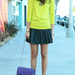 We spotted Ashley Madekwe working the trend with a bright J.Crew sweater and a pop of purple on her bag.