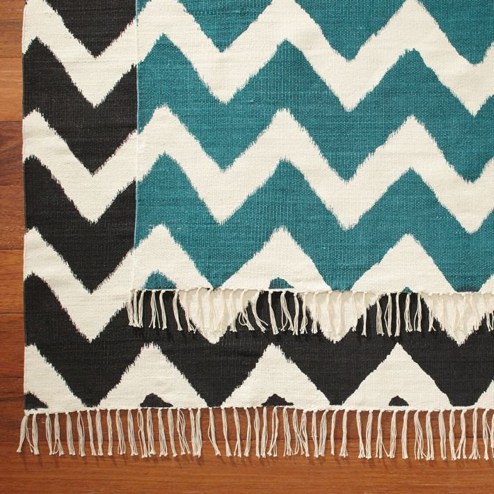 We like how these Capri Mats ($70-$350) combine a modern zigzag pattern with traditional fringe.