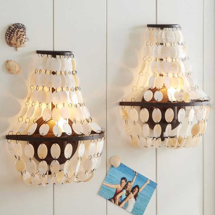 If you don't have space for a statement chandelier, designate a wall to adorn with these incredibly chic Shell Swag Sconces ($80-$150). We especially like the contrast of the rustic iron finish with the iridescent shells.