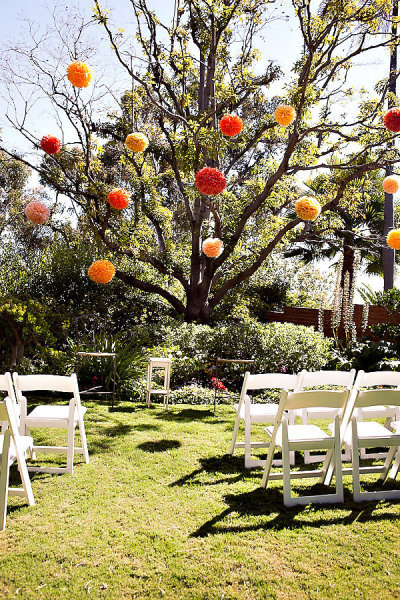 Don't just think about what can stand on the ground — consider adding unique touches to surrounding trees or structures for a greater visual impact. Photo by Ashleigh Taylor Photography via Style Me Pretty