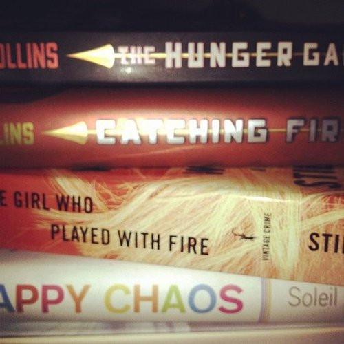 POPSUGAR Moms shares a stack of great reads including The Hunger Games, The Girl Who Played With Fire, and Happy Chaos.