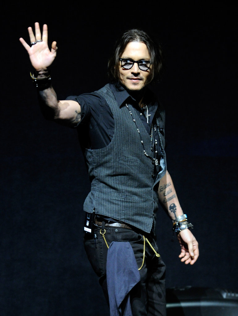Johnny Depp waved to the crowd at CinemaCon.