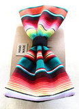 Handmade with a traditional Mexican fabric, the Serape Fabric Clip-On Bow ($10) would be a great add-on for favor boxes.