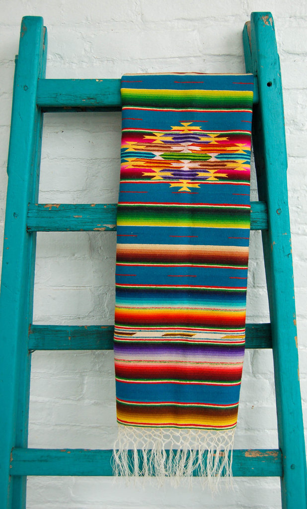 For a festive feast, set this Antique Mexican Saltillo Serape Runner ($64) beneath your food spread — the vibrant hues are sure to spice up your decor.