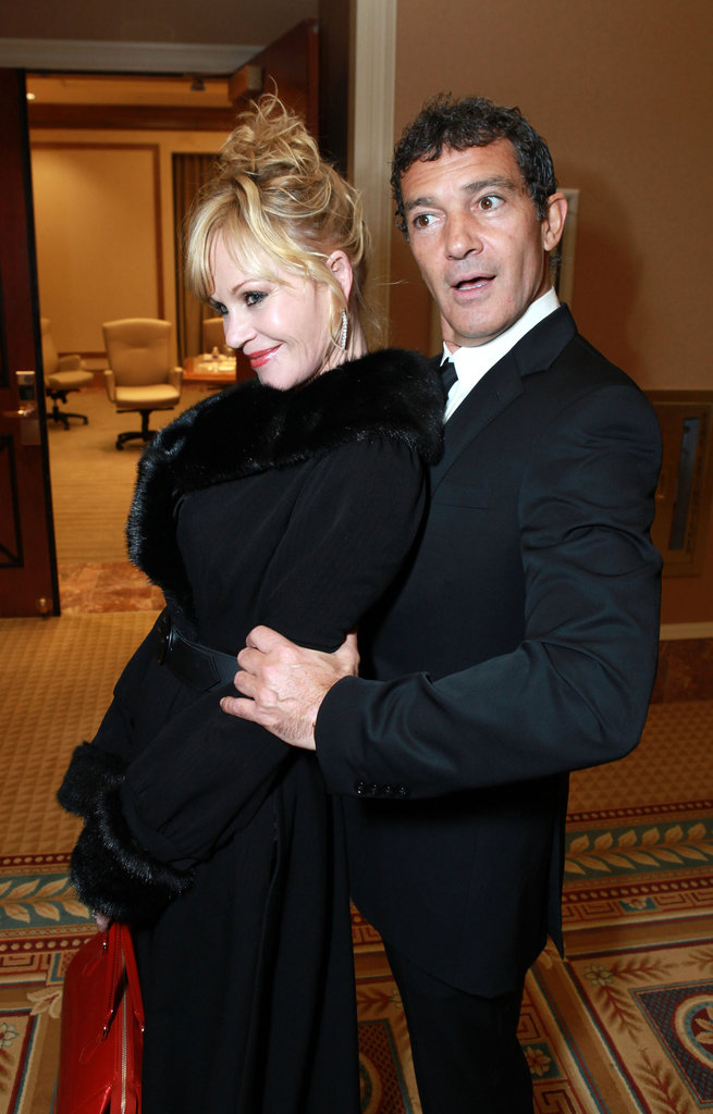 Antonio Banderas played around with Melanie Griffith at a dinner honoring Jeffrey Katzenberg at CinemaCon in Las Vegas.