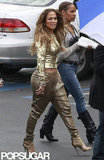 Jennifer Lopez walked to set with a friend.