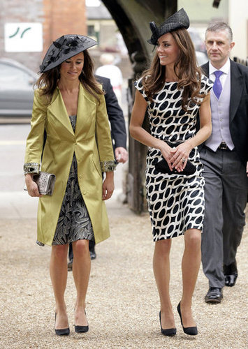 Kate and sister Pippa stepped out in sweet printed sheaths for a family friend's wedding.