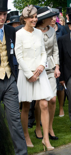 Kate was the picture of derby elegance in a white Reiss skirt suit. To accessorize, she added LK Bennett shoes and an LK Bennett purse.