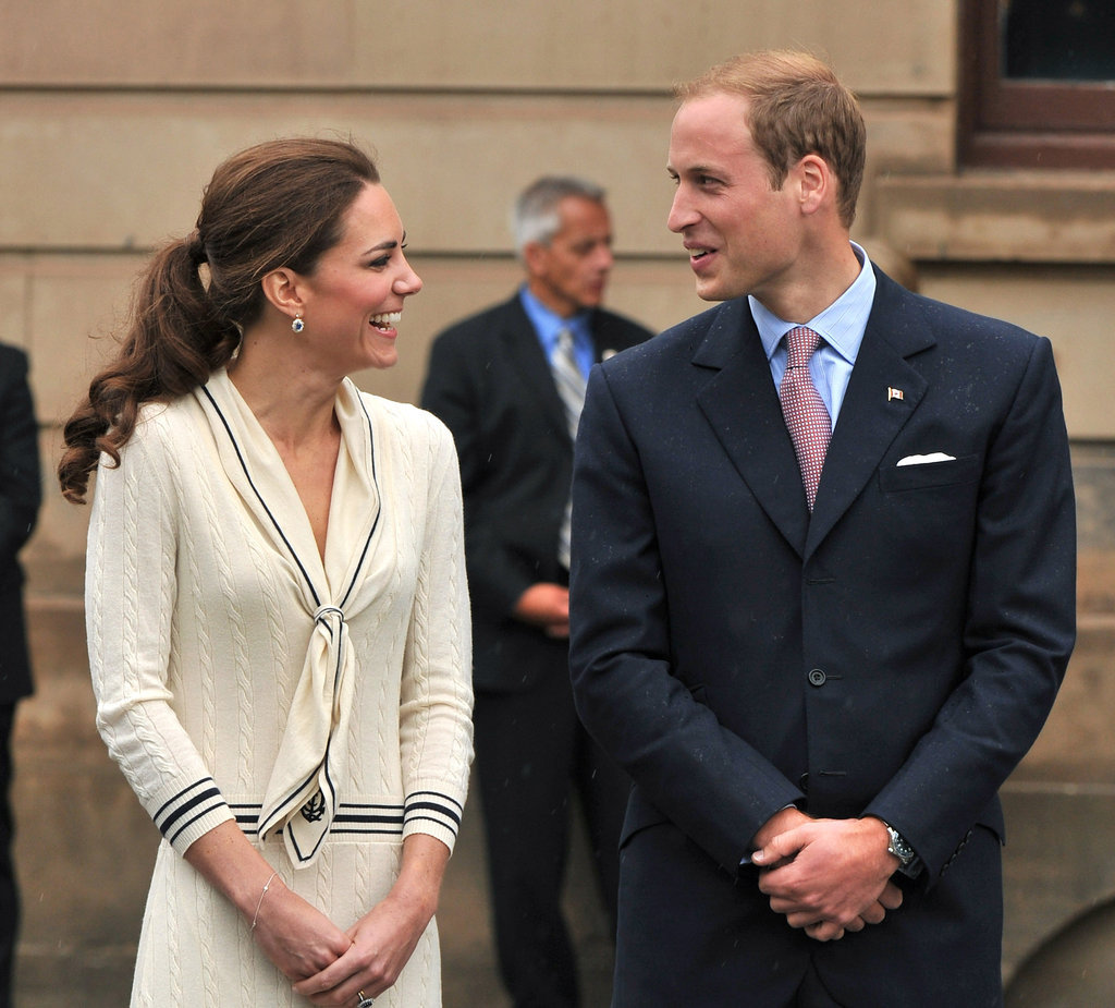 They shared a private joke while in Charlottetown, Canada, in July 2011. For the occasion, Kate chose an Alexander McQueen sailor-inspired dress and navy pumps.