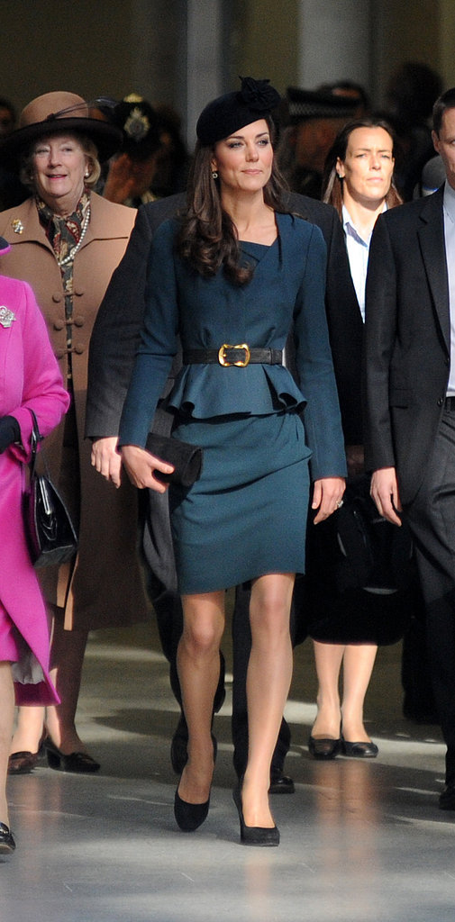Kate wore a peplum skirt suit from LK Bennett, one of her favorite High Street shops, with Rupert Sanderson pumps.