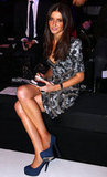 Kate Waterhouse wore a printed dress front row at Konstantina Mittas in 2010.