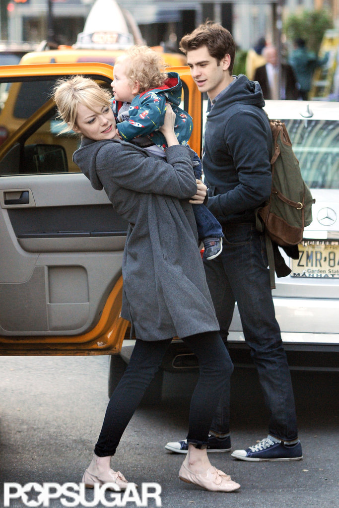 Emma Stone smiled while holding a friend's son in NYC.