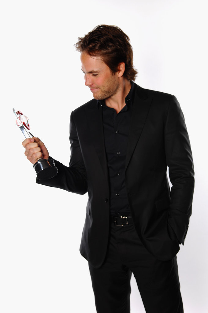 Taylor Kitsch admired his award for male star of tomorrow at the CinemaCon awards ceremony in Las Vegas.