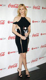 Charlize Theron wore a sexy black dress with cutouts and accepted the distinguished decade of achievement in film award at the CinemaCon awards ceremony in Las Vegas.