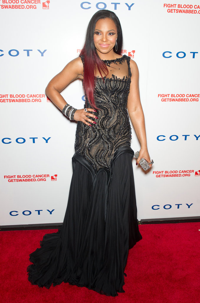 Ashanti showed off a black gown with an intricately embellished bodice and a touch of auburn in her hair.