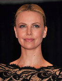 Charlize Theron wore black lace to the White House Correspondant's Dinner.