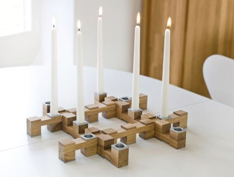 This modern Oval Oak Meccano Candleholder ($45) fits together like a jigsaw puzzle.
