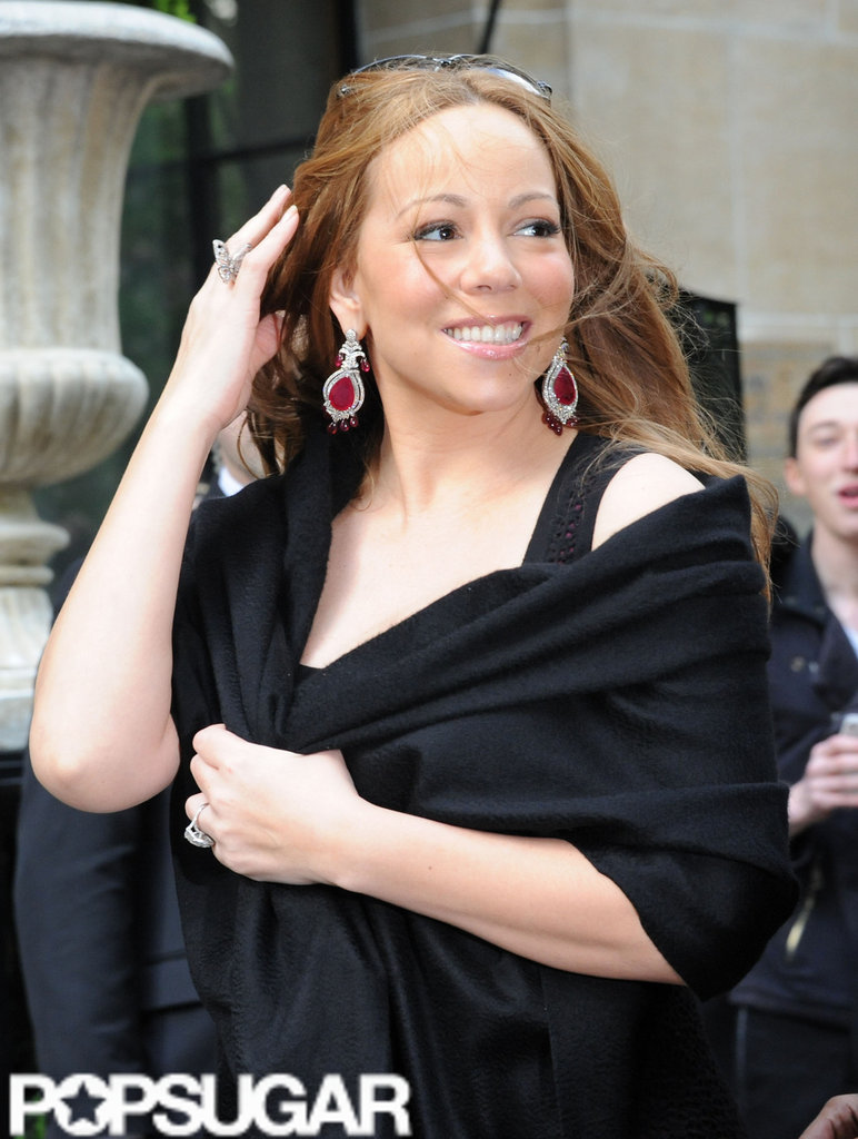 Mariah Carey wore some large ruby earrings as she left her hotel in Paris.