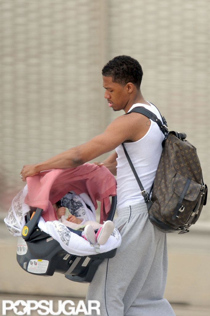 Nick Cannon made sure Monroe Cannon was comfortable in her carrier at the airport in Paris.