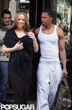 Mariah Carey wore an all-black ensemble while husband Nick Cannon chose all white leaving their hotel in Paris.