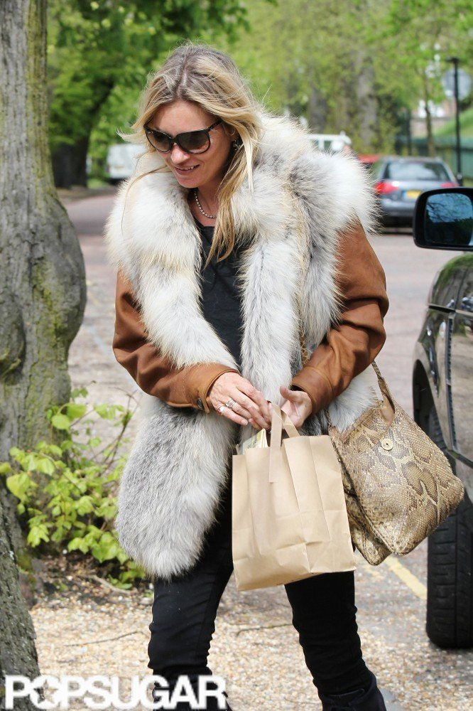 Kate Moss carried a brown bag and a snakeskin tote.