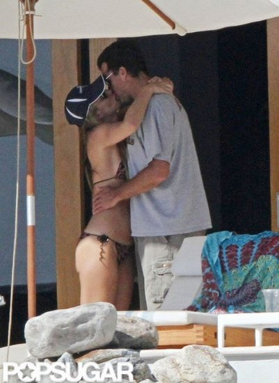 Bikini-clad Molly Sims and then-boyfriend Scott Stuber shared a sweet kiss in February 2011.