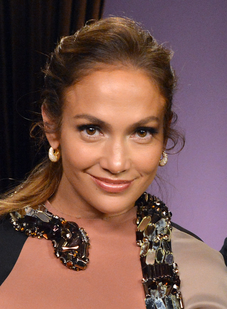 Jennifer Lopez smiled at a press conference to announce her Mega tour.