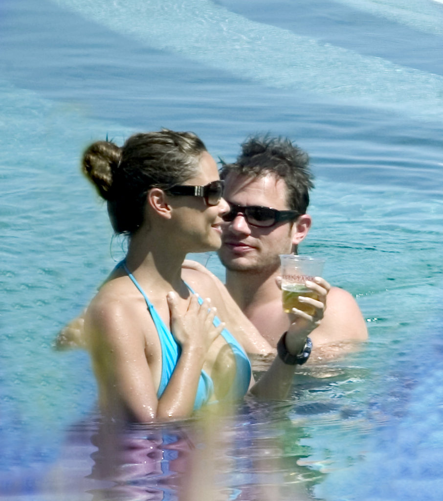 Nick Lachey and Vanessa Minnillo went for a swim with their drinks in June 2006.
