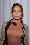 Jennifer Lopez showed off her Lanvin dress with a snake around the neck.