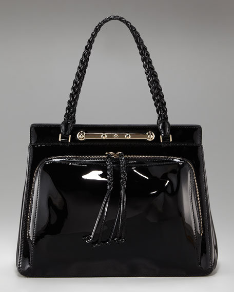 Sleek and structured with a stud latch bar closure, this patent-leather handbag is dressy, elegant, and versatile. Valentino Demetra Patent Leather Satchel ($2,245)