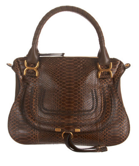 Made with python and grained leather, this equestrian-inspired handbag is ideal for everyday use.  Chloé Python Marcie Small Satchel ($3,895)