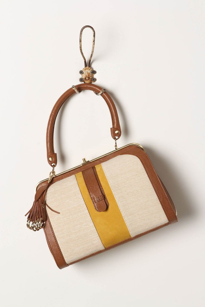 A mustard stripe adds a modern touch to the retro-inspired handbag. Anthropologie Vivenne Satchel ($198)