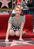 Scarlett Johansson knelt next to her new star on the red carpet.