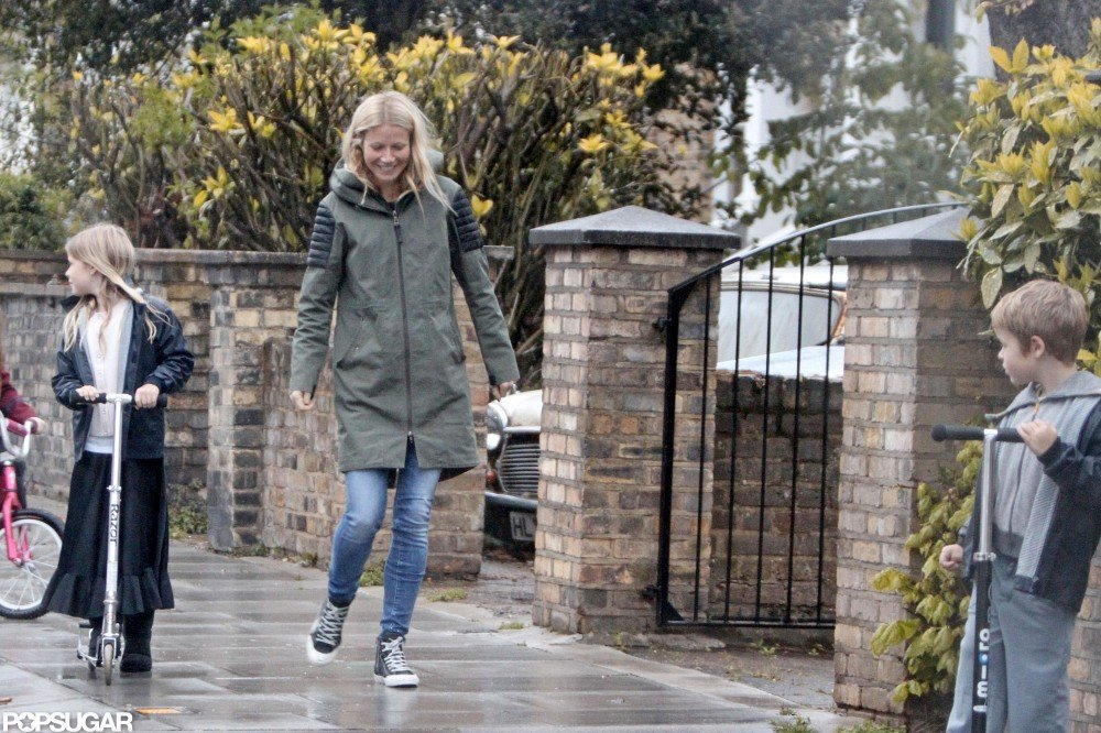 Gwyneth Paltrow walked in rainy London with kids Apple Martin and Moses Martin.