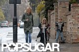 Gwyneth Paltrow walked in London with kids Apple Martin and Moses Martin.