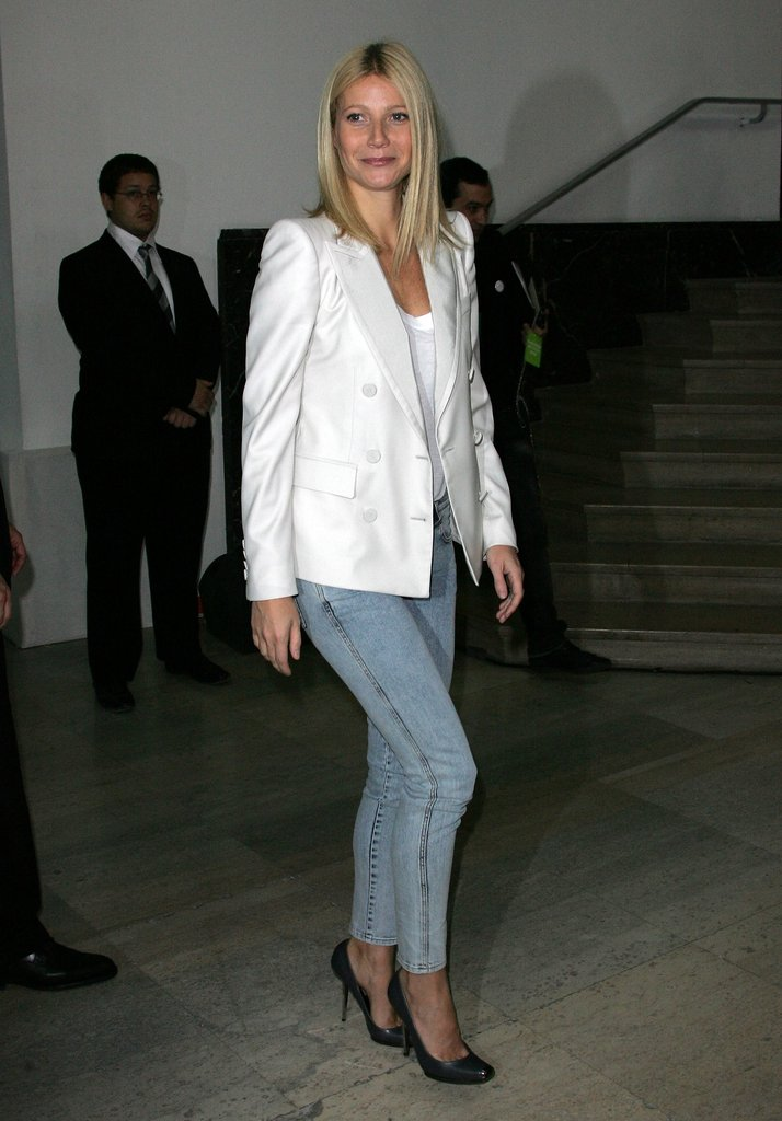Here Gwyneth paired a white double-breast blazer with '80s-style skinny jeans and pumps. Get her look below.  6826060