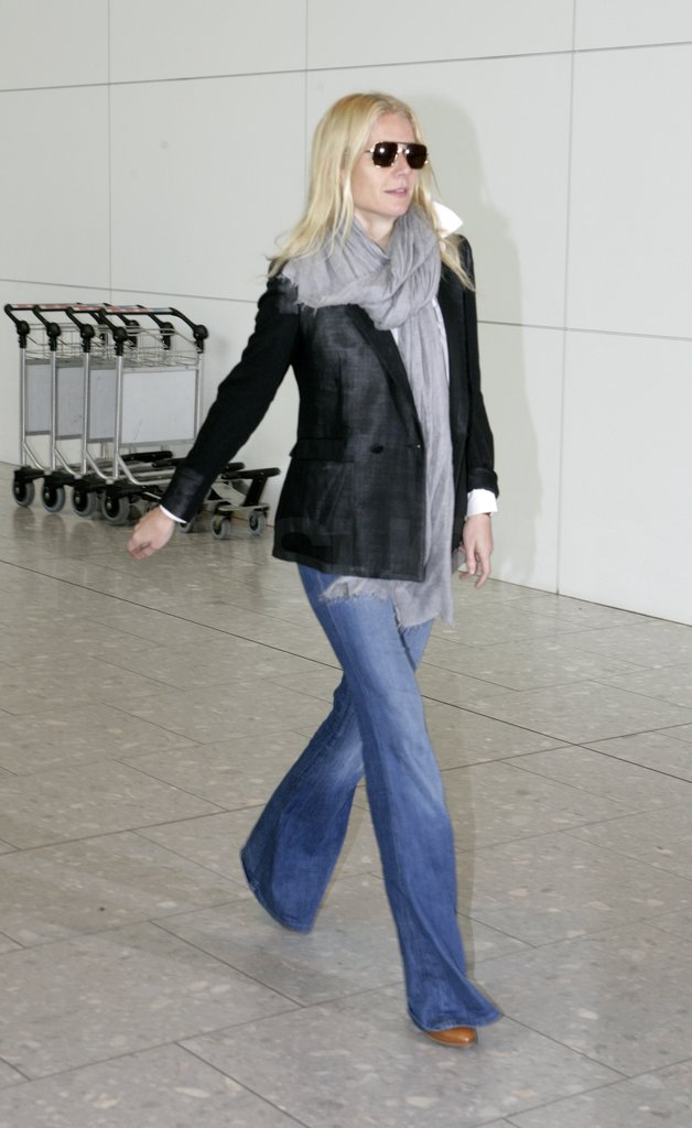 Spotted at London's Heathrow airport, Gwyneth chose a black blazer but ditched the skinny jeans for wide leg.  Get Gwyneth's airport look below. 6826082