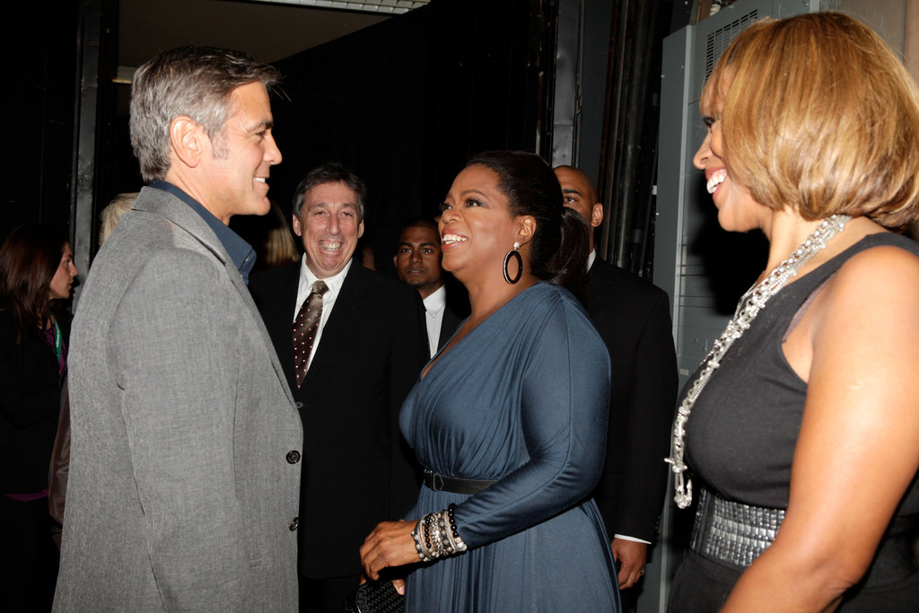 George Clooney made Oprah Winfrey and Gayle King laugh at a Toronto event in September 2009.