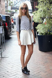 We think her nautical striped tee tucked into a pretty white circle skirt is a Summer wardrobe must.