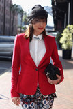 An eclectic blend of ladylike accents (a vintage veil, pearl necklaces under a pointed collar, and Prada clutch) with bolder pieces (a red blazer and printed Zara jeans) made a cool impression.