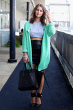 For cool-girl inspiration, this crop top, leather pencil skirt, and oversize mint-hued cardigan look had just the right amount of edgy appeal.