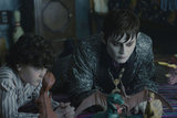 Gulliver McGrath as David Collins and Johnny Depp as Barnabas Collins in Dark Shadows.  Photo courtesy of Warner Bros.