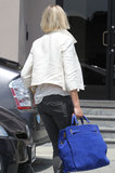Cameron Diaz toted a blue bag.