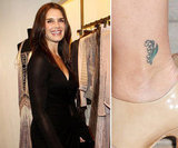Brooke Shields has a tiny flower on her left ankle.