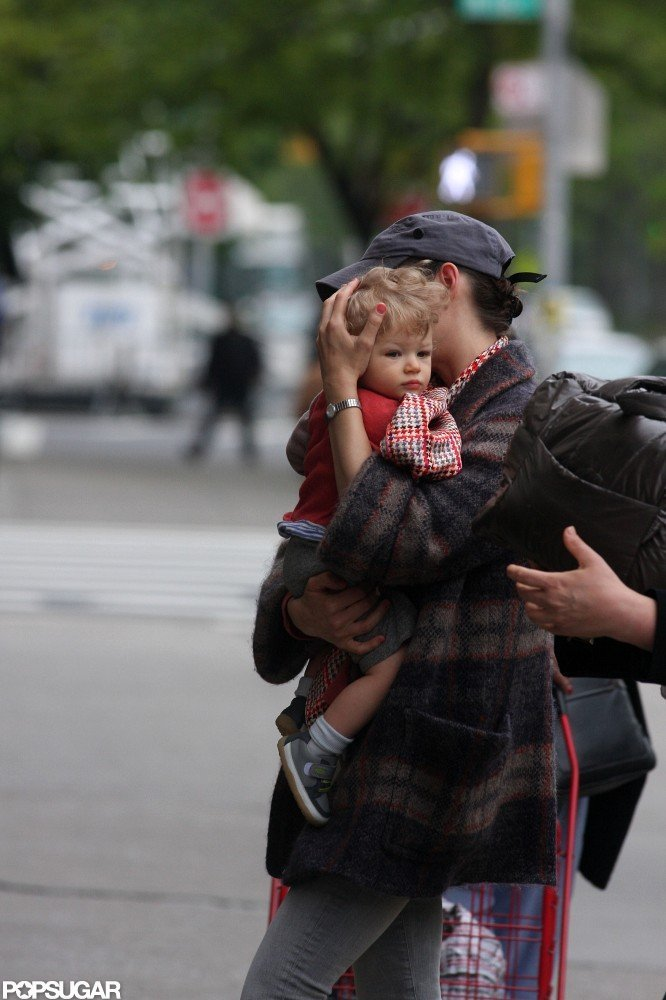 Marion Cotillard held her son Marcel close while he visited her on set in NYC.