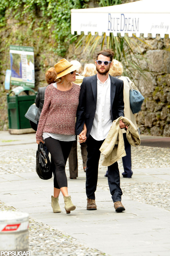 Sienna Miller and Tom Sturridge were hand-in-hand while hitting the streets of Italy.