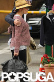 Sienna Miller's baby bump was exposed under her Rag & Bone sweater while vacationing with Tom Sturridge in Italy.