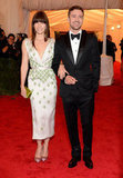 Jessica Biel wore a pale pink silk dress with green beading and was accompanied by Justin Timberlake at the Met Gala together.