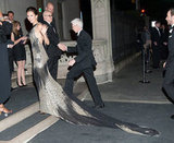 Nina Dobrev dragged the long train of her Donna Karan gown across the sidewalk as she headed into an afterparty.