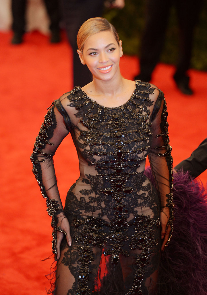 Beyoncé Knowles was all smiles arriving at the Met Gala in a Givenchy design.